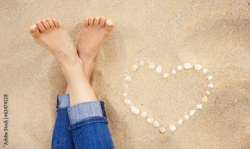 canvas print picture Closeup of female feet at the beach