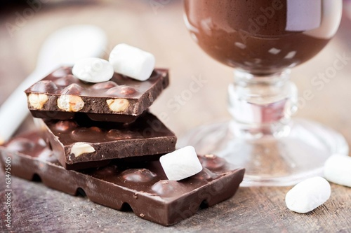 Tile dark chocolate with hazelnuts, marshmallows, hot drink