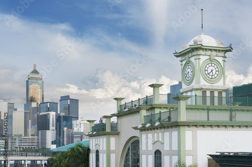 Old clock Tower and modern building in Hong Kong