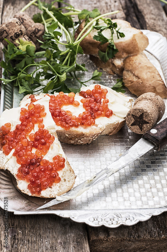 Sandwiches with red caviar,butter and bread