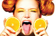 Beauty joyful teen girl with juicy oranges. Freckles