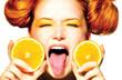 Beauty joyful teen girl with juicy oranges. Freckles