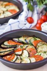 Ratatouille, vegetables cut into slices, eggplant, zucchini