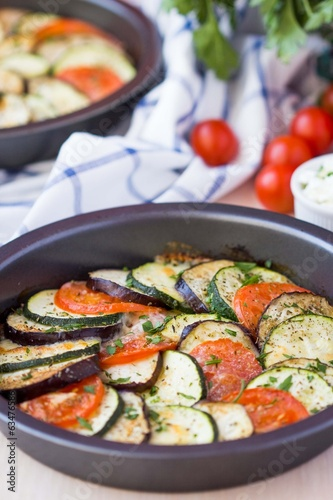 Ratatouille, vegetables cut into slices, eggplant, zucchini