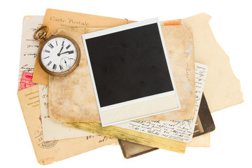 pile of old photos with antique clock