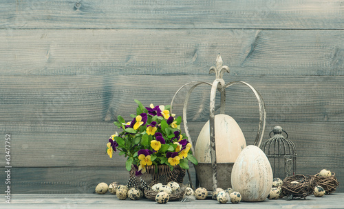 easter decoration with eggs and pansy flowers
