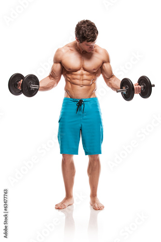 Muscular bodybuilder guy doing exercises with dumbbells over whi