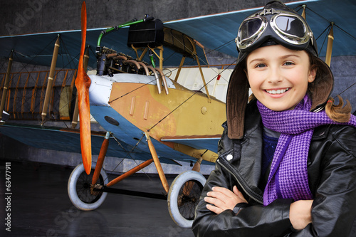 Aviator, happy girl ready to travel with plane.