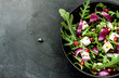Fresh spring salad with rucola, feta cheese and red onion - 63478100