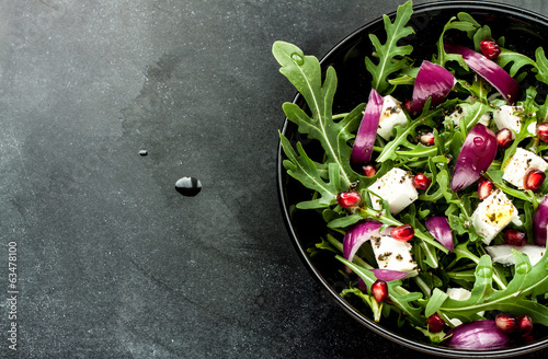 Foto op Canvas Voorgerecht Fresh spring salad with rucola, feta cheese and red onion