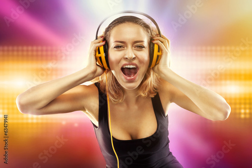 Happy woman listening music with headphones