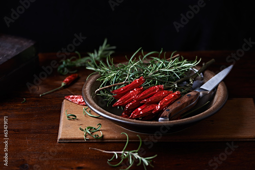 Dried Chili Peppers and Fresh Rosemary
