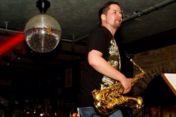 saxophone player with disco ball