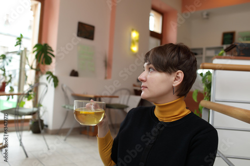 Woman with glass of tea