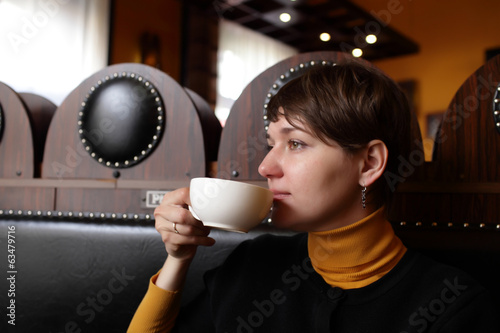Woman with white cup of tea