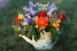 Bright summer bouquet in watering can
