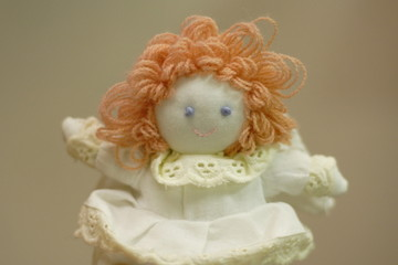 Knitted doll in a white dress