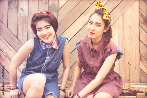 couple young pretty women in vintage retro clothe