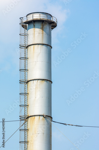Factory Chimney Of Coal Power Plant Against Blue Sky