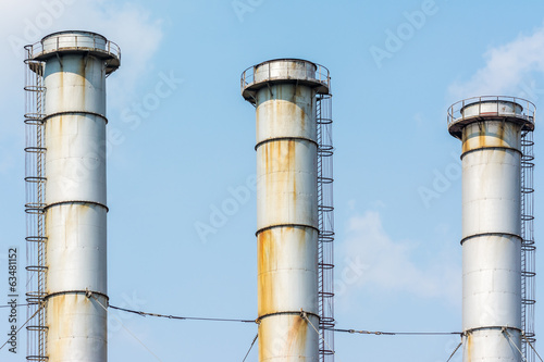 Factory Chimneys Of Coal Power Plant Against Blue Sky
