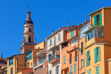 Colorful houses and belfry in Menton, France.