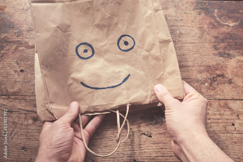 Smiling face on paperbag