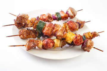Grilled skewers with meat and vegetables on dish