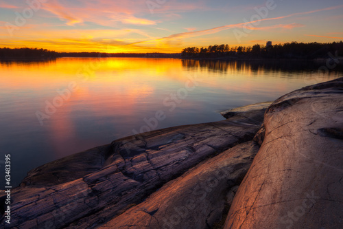 Beach rock with sunrise in coast of  Helsinki