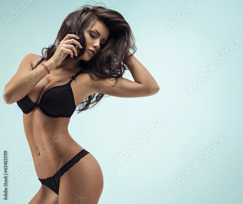 Brunette woman posing in black lingerie
