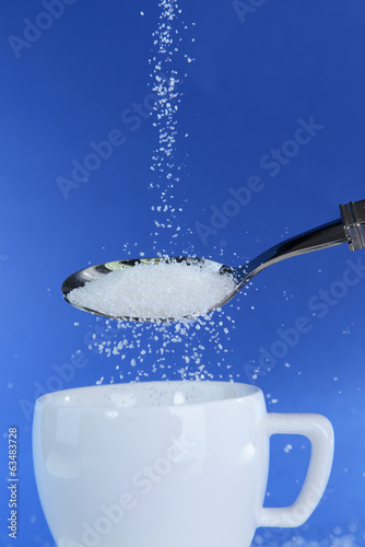 Sugar on blue background