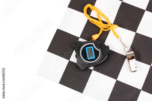 Checkered finish flag with whistle and stopwatch isolated