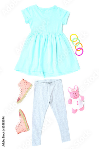 Beautiful clothes for little girl, isolated on white