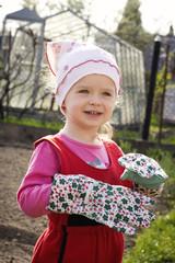 Little girl helping in the garden