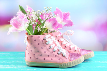 Beautiful gumshoes with flowers inside