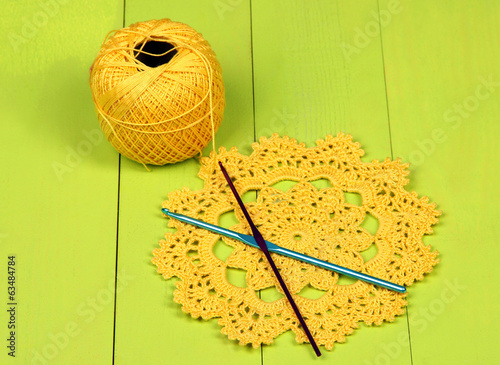 Yellow yarn for knitting with napkin and spokes