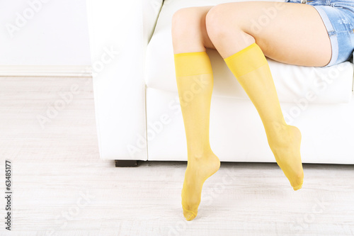 Socks on perfect woman legs, close up