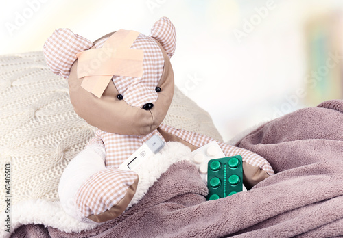 Sick bear in bed close-up