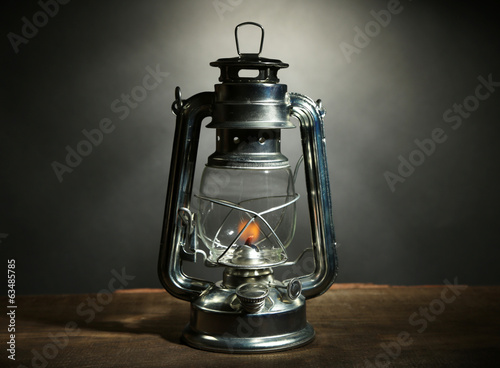 Kerosene lamp on dark grey background
