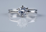 Beautiful diamond ring on light background - 63485926