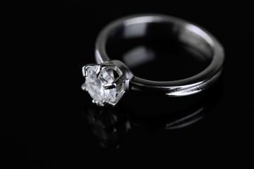 Beautiful diamond ring isolated on black