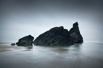 Sea stacks on a beach in Cornwall.