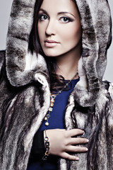 Beautiful elegant woman in a fur coat