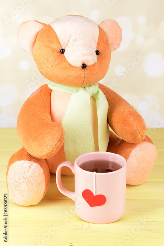 Bear toy on table on light background