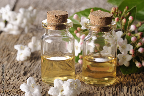 spa oil with flowers on a wooden table