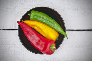 Three colored peppers closeup