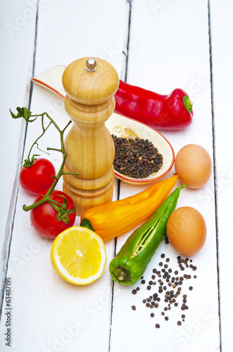Fresh vegetables and eggs on wooden background