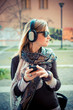 youg beautiful blonde woman listening to music