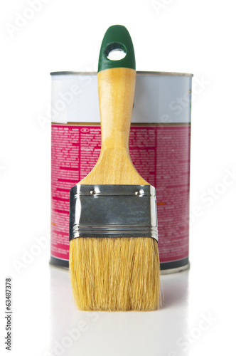 Paint brush with paint can on white background