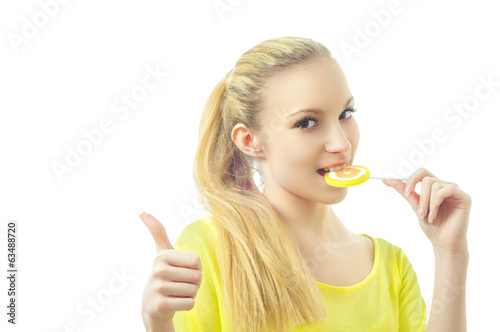 Girl eating candy showing OK