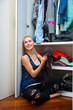teen girl choosing clothes in front of closet